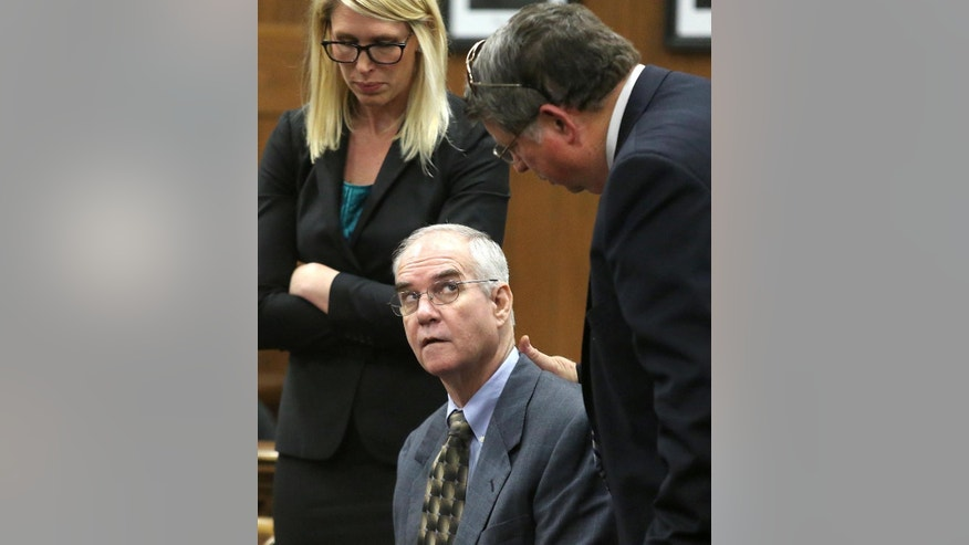 Ed Graf, center, looks at Don Youngblood, right, as defense attorney Michelle Tuegel, left, looks on after pleading guilty to the murder of his two sons during his retrial, Tuesday, Oct. 21, 2014, in Waco, Texas. (AP Photo/Waco Tribune Herald, Jerry Larson)
