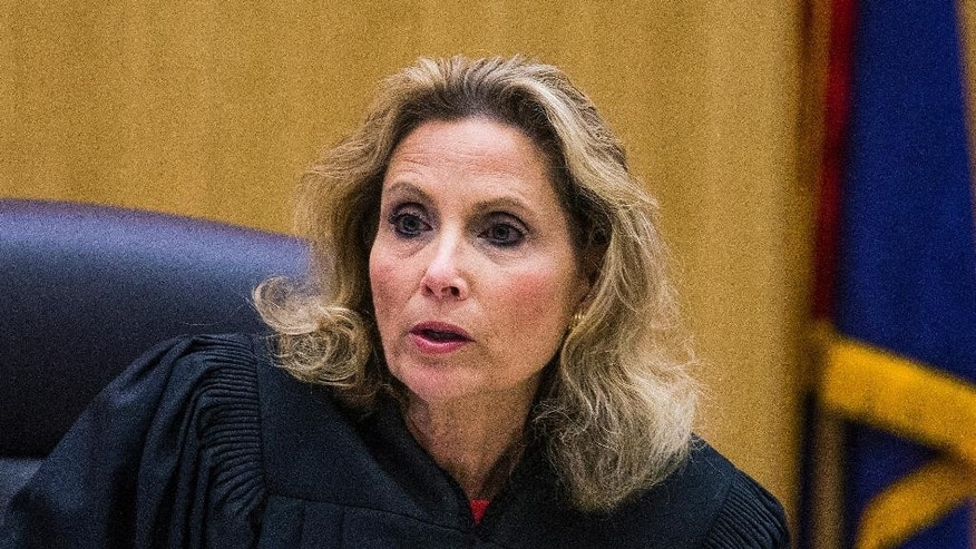 Maricopa County Superior Court Judge Sherry Stephens reads instructions to the jury in Phoenix, Tuesday, Oct. 21, 2014, as the penalty phase of the Jodi Arias retrial begins.  Arias was found guilty of first degree murder in the death of former boyfriend Travis Alexander, but the jury deadlocked on whether to give her the death penalty or life in prison.  (AP Photo/The Arizona Republic, Tom Tingle, Pool)