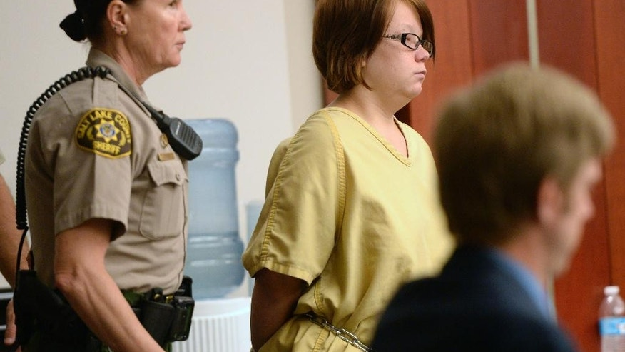 FILE - In this Sept. 10, 2014 file photo, Alicia Marie Englert makes her initial appearance in court, in Salt Lake City. Prosecutors agreed to a significant bail reduction Monday, Oct. 20, 2014 for Englert, accused of leaving her newborn baby in a trash can to die. Bail for Englert was reduced to $25,000. Englert will also be evaluated to see if she's mentally competent to stand trial on an attempted murder charge. (AP Photo/The Salt Lake Tribune, Al Hartmann, Pool, File)
