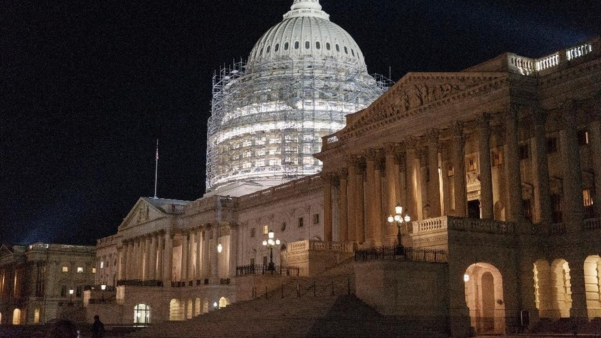 This photo taken Oct. 4, 2014 shows scaffolding around the Capitol Dome in Washington. Two weeks before election day, the nation's likely voters have started seeing eye-to-eye with the election prognosticators. Most now expect the Republican Party to take control of the U.S. Senate, according to a new Associated Press-GfK poll. And by a growing margin, more say that's the outcome they'd like to see.  (AP Photo/J. Scott Applewhite)