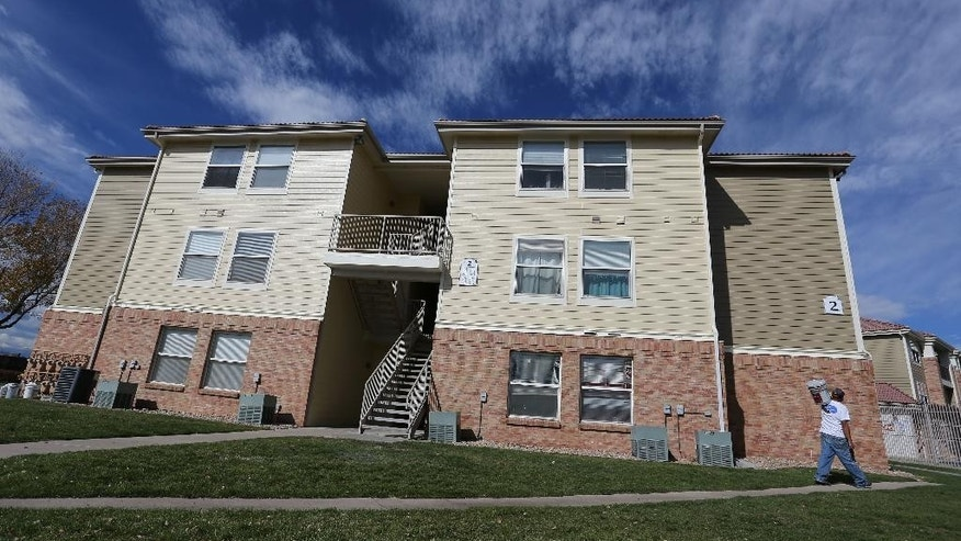This Wednesday, Oct. 22, 2014, photo shows the apartment building in Aurora, Colo., which police say is the home of two of the three teenage girls who, according to U.S. authorities, were en route to join the Islamic State group in Syria when they were stopped at an airport in Germany. The two sisters, ages 17 and 15, and their 16-year-old friend were stopped at the airport in Frankfurt, Germany, after the U.S. informed authorities at the airport about the girls arriving alone and headed to Turkey en route to Syria. (AP Photo/Brennan Linsley)
