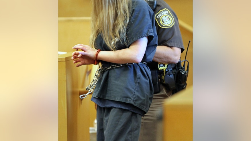 FILE - In this Aug. 1, 2014 file photo, one of the two girls accused of stabbing another girl is led into the courtroom during court proceedings at Waukesha County Court in Waukesha, Mich. A Wisconsin judge is deciding whether one of two 12-year-old girls accused of stabbing a classmate to please a fictional online horror character is mentally fit to stand trial. (AP Photo/Milwaukee Journal-Sentinel, Michael Sears, Pool, file)