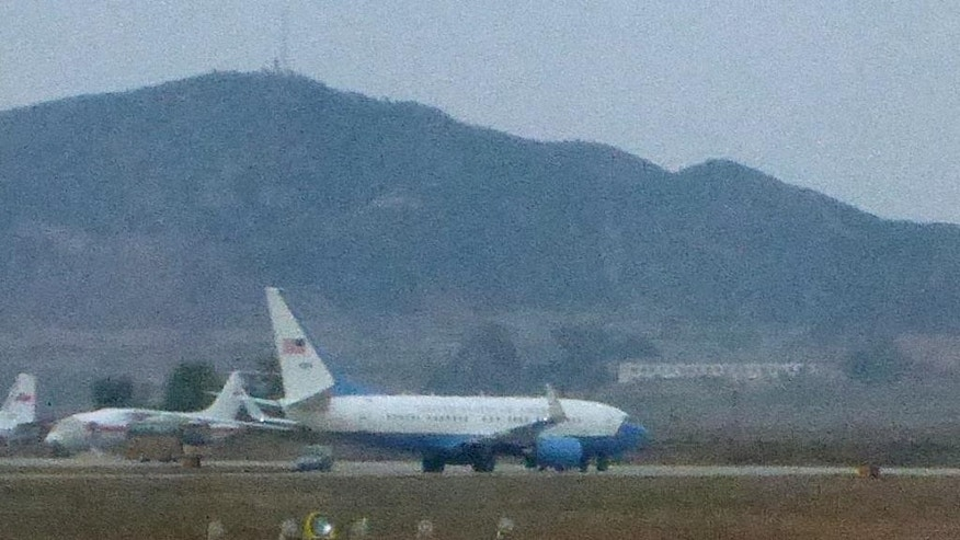 What appears to be a United States Air Force passenger jet, right, is parked on the tarmac of Sunan International Airport in Pyongyang, North Korea, Tuesday, Oct. 21, 2014. The State Department says Jeffrey Fowle, one of three Americans being held in North Korea, has been released. State Department deputy spokeswoman Marie Harf said Fowle was on his was home Tuesday after negotiators left Pyongyang.  She said the U.S. is still trying to free Americans Matthew Miller and Kenneth Bae.  (AP Photo/Wong Maye-E)