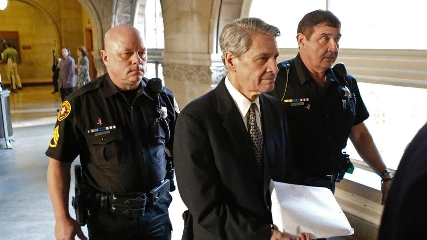 Dr. Robert Ferrante, center, is escorted by Allegheny County Sheriffs deputies to court during jury selection for his trial on homicide charges in the 2013 killing of his neurologist wife with cyanide on Thursday, Oct. 23, 2014, in Pittsburgh. Ferrante has denied the allegations. (AP Photo/Keith Srakocic)
