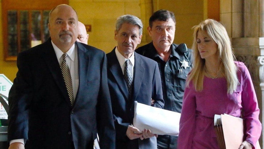 Dr. Robert Ferrante, center, follows his attorneys, William Difenderfer, left, and Wendy Williams, right, as he is escorted by Allegheny County Sheriffs deputies to court  on Thursday, Oct. 23, 2014, in Pittsburgh. during jury selection for his trial on homicide charges in the 2013 killing of his neurologist wife with cyanide. (AP Photo/Keith Srakocic)