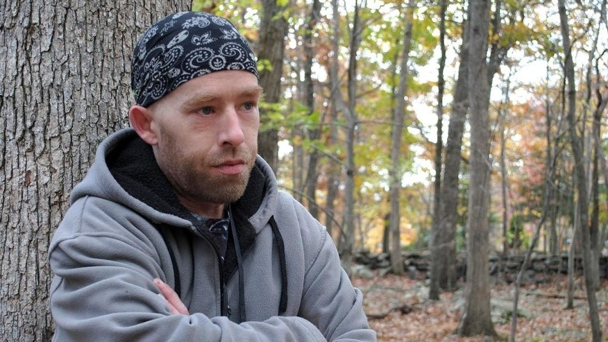 In this photo taken on Monday, Oct. 20, 2014, James Tully, of Canadensis, Pa., poses for a photo.  The northeastern Pennsylvania man says he's been stopped at least 20 times by authorities who have mistaken him as Eric Frein, the suspect in a trooper's killing. Tully walks to work through the rural search area because he doesn't own a car. He also wears a backpack, an item police believe Frein has also carried. (AP Photo/Pocono Record, Beth Brelje) MANDATORY CREDIT