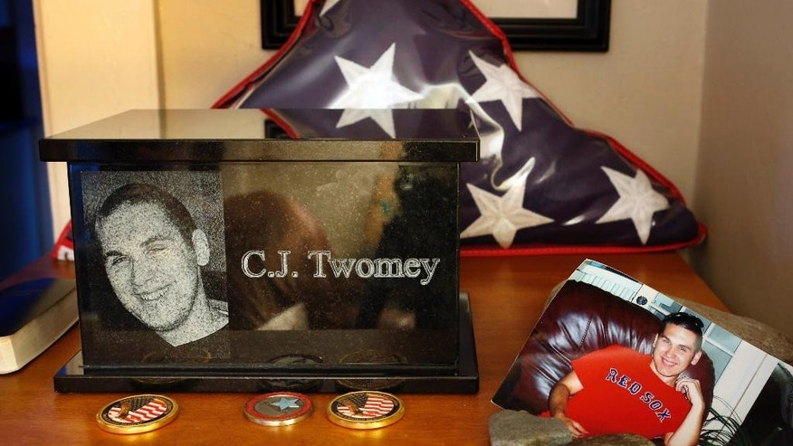 FILE - In this Dec. 17, 2013 file photo, an urn containing the ashes of C.J. Twomey sits on a shelf at his parent's home in Auburn, Maine. C.J. committed suicide three and a half years earlier. On Thursday, Oct. 23, 2014, a rocket containing a vial of C.J.'s ashes was launched from the New Mexican desert into space before landing in the White Sands Missile Range. His ashes had previously been released in nearly all 50 states and dozens of places overseas.  (AP Photo/Robert F. Bukaty, File)