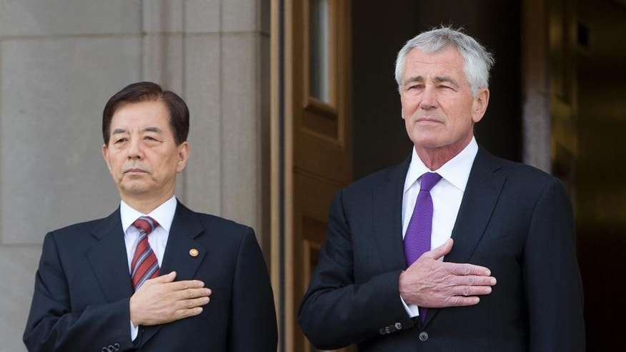 Defense Secretary Chuck Hagel greets Korean National Defense Minister Han Min Koo as he arrives for an honor cordon, Thursday, Oct. 23, 2014, at the Pentagon. (AP Photo/Carolyn Kaster)