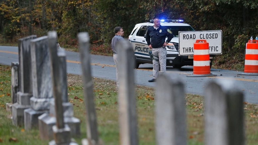 FILE - In this Saturday, Oct. 18, 2014 file photo,  Police block the road leading to the scene of a death investigation in connection with the disappearance of University of Virginia student Hannah Graham in Albermarle County, Va. Remains found nearly a week ago in a rural area of Virginia are those of Hannah Graham, a university student who disappeared last month, authorities said Friday, Oct. 24, 2014 ending a search that left the campus and community on edge. (AP Photo/Steve Helber, File)