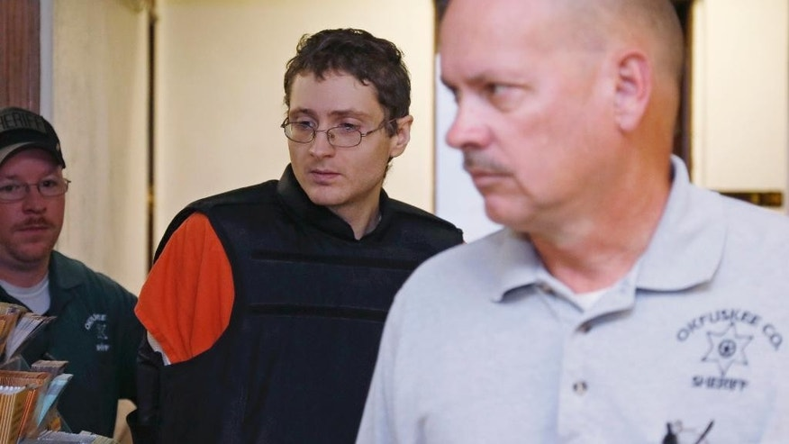 Kevin Sweat, center, is escorted in the Okfuskee County Courthouse on his way to his sentencing hearing  Okemah, Okla., Friday, Oct. 24, 2014. Sweat was sentenced  to three life sentences. He pleaded guilty in the 2008 deaths of 11-year-old Skyla Whitaker and 13-year-old Taylor Paschal-Placker, whose deaths went unsolved until he was arrested in the 2011 killing of his fiancee, Ashley Taylor. (AP Photo/Sue Ogrocki)