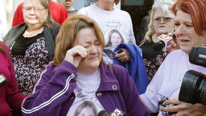 Patricia Taylor, the mother of murder victim Ashley Taylor,  wipes a tear away as she talks about her daughter, outside the courthouse in Okemah, Okla., Friday, Oct. 24, 2014, following the sentencing of Kevin Sweat.  Sweat was sentenced  to three life sentences. He pleaded guilty in the 2008 deaths of 11-year-old Skyla Whitaker and 13-year-old Taylor Paschal-Placker, whose deaths went unsolved until he was arrested in the 2011 killing of his fiancee, Ashley Taylor. (AP Photo/Sue Ogrocki)