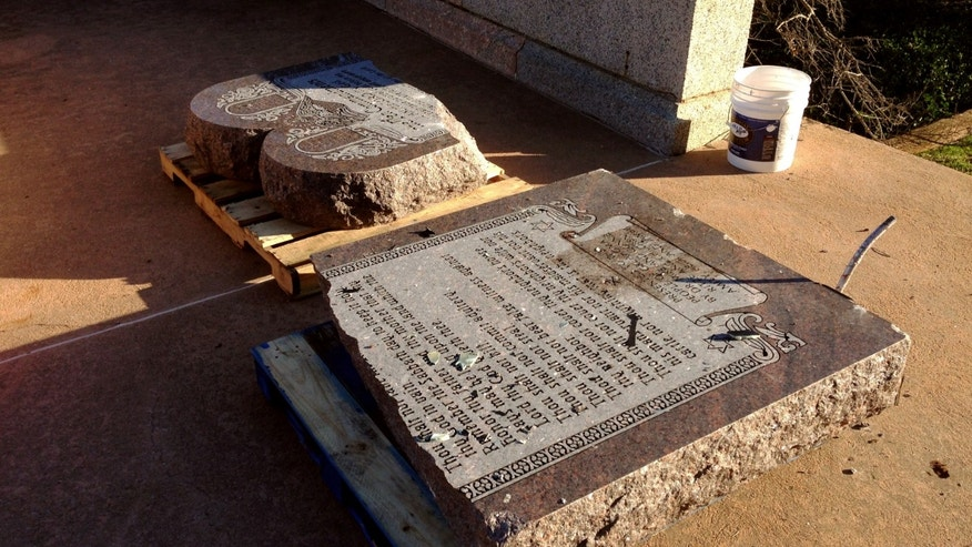 Oct. 24, 2014: The damaged remains of a Ten Commandments monument are gathered on the Oklahoma State Capitol grounds in Oklahoma City. (AP/Sean Murphy)