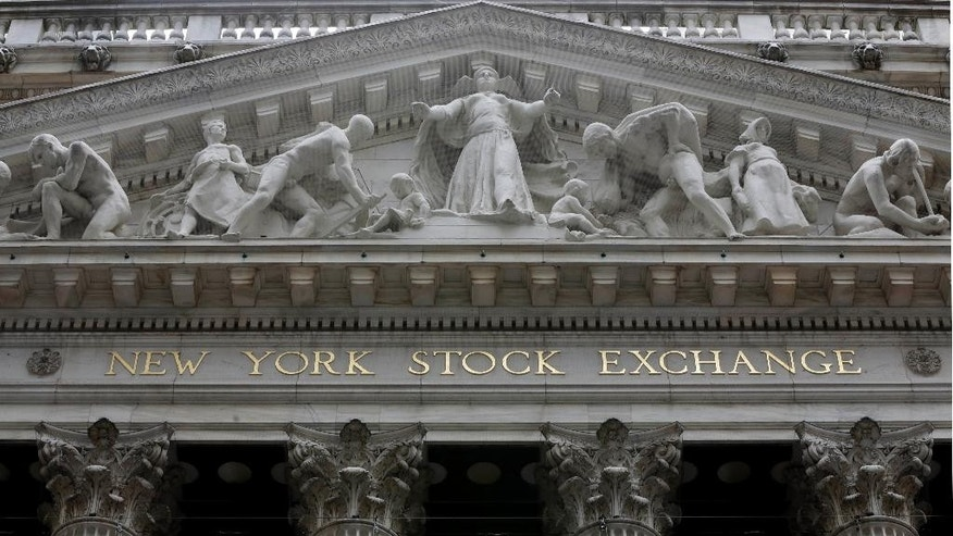 This Thursday, Oct. 2, 2014 photo shows the facade of the New York Stock Exchange. U.S. stocks rose again Friday, Oct. 24, 2014, putting the market on track for the best week in almost two years. Amazon plunged after the company reported dismal third-quarter results, but that wasn't enough to drag the rest of the market down. (AP Photo/Richard Drew)