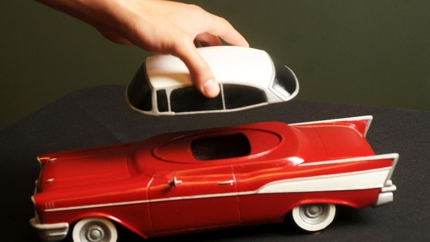 In this Oct. 23, 2014 photo, a composite ceramic custom printed 3-D funeral urn depicting an automobile, made by Foreverence, is seen in Eden Prairie, Mn. Foreverence sells the urns via funeral directors, The St. Paul Pioneer Press reported. (AP Photo/The St. Paul Pioneer Press, Scott Takushi)