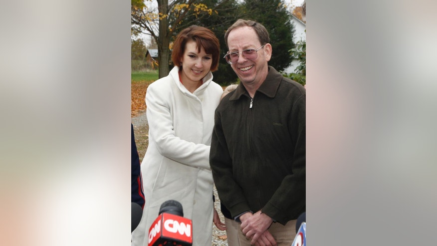 Jeffrey Fowle, right, stands with his wife Tatyana Fowle at their home in West Carrollton, Ohio, Wednesday, Oct. 22, 2014. Fowle was arrested and held for nearly six months in North Korea after leaving a Bible at a nightclub. Christian evangelism is considered a crime in North Korea.   (AP Photo/David Kohl)