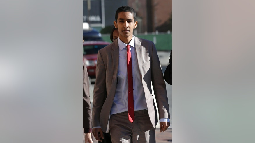 Robel Phillipos, a college friend of Boston Marathon bombing suspect Dzhokhar Tsarnaev, arrives at federal court on a day of jury deliberations in his trial, Monday, Oct. 27, 2014, in Boston. Phillipos is accused of lying about being in Tsarnaev's dorm room three days after the deadly bombing, when two other friends removed a backpack containing fireworks and other potential evidence. (AP Photo/Steven Senne)