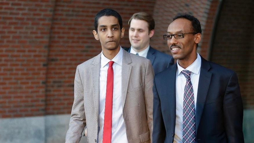 FILE - In a Monday, Oct. 27, 2014 file photo, Robel Phillipos, left, a college friend of Boston Marathon bombing suspect Dzhokhar Tsarnaev, departs federal court with defense attorney Derege Demissie, right, following jury deliberations in his trial, in Boston. Phillipos was convicted Tuesday, Oct. 28, 2014 of lying during the investigation into the 2013 attack. (AP Photo/Steven Senne, File)