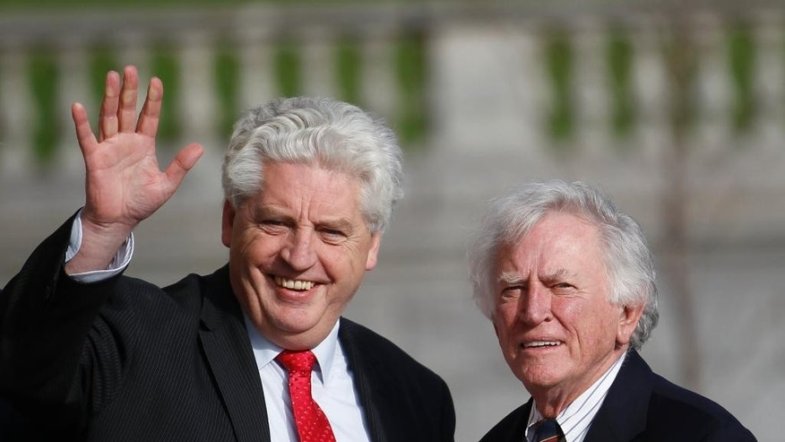 The newly appointed U.S. envoy to Northern Ireland, former Sen. Gary Hart, right, and Alasdair McDonnell, leader of the Social Democratic and Labour Party, pose for photographers outside Parliament Buildings, Stormont, in Belfast, Northern Ireland, Wednesday, Oct. 29, 2014. Hart is scheduled to meet the leaders of all five parties in Northern Ireland's unity government Wednesday and Thursday. Hart is seeking to broker compromise on a wide range of issues threatening to tear apart the 7-year-old coalition of British Protestants and Irish Catholics. (AP Photo/Peter Morrison)
