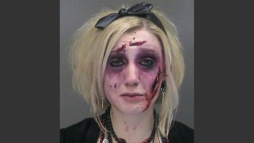 "Catherine Butler of Rochester, N.Y. is seen in a booking photo provided by the Gates, N.Y., Police Department. Police say Butler, wearing a zombie costume and makeup, was charged with drunken driving twice within three hours Saturday, Oct. 25, 2014 after attending a Rochester bar's ""zombie prom"" party. (AP Photo/Gates, N.Y., Police Department via member WHAM-TV)"