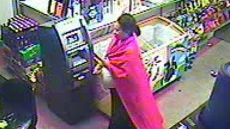 Authorities in Atlanta are trying to foil a robbery suspect described as pregnant and wearing a large, red cape.