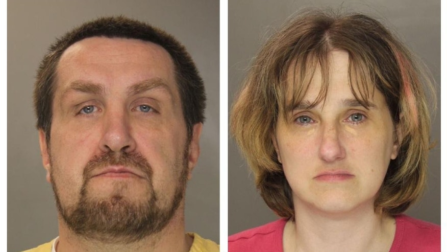 In this undated combination of photos provided by the Harrisburg Police Department Jarrod Tutko and his wife Kimberly are shown.  A preliminary hearing is scheduled Thursday, Oct. 30, 2014 for couple, charged with homicide in the starvation death of their 9-year-old son, whose decomposing body was found when police were called to their Harrisburg home two months ago.  (AP Photo/Harrisburg Police Department)