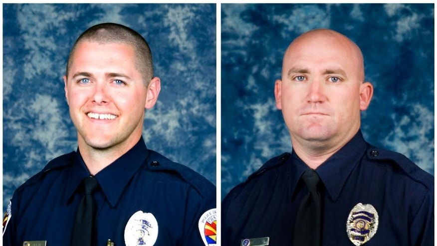 This combination of undated photos provided by the Chandler Police Department shows police officers Bryant Holmes, left, and David Payne. Holmes was killed by an SUV on Tuesday, Oct. 28, 2014, when it ran a red light and hit his motorcycle in Chandler, Ariz. Payne, 37, was killed on Friday, Oct. 31, when a vehicle struck his motorcycle from behind at a red light. (AP Photo/Chandler Police Department)