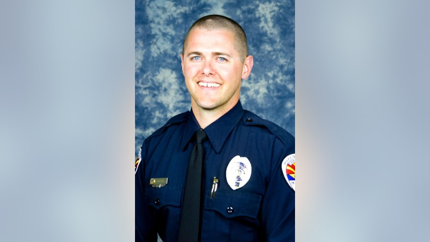 This undated photo provided by the Chandler Police Department shows police officer Bryant Holmes, who was killed by an SUV on Tuesday, Oct. 28, 2014, when it ran a red light and hit his motorcycle in Chandler, Ariz. A second Chandler officer, 37-year-old David Payne, was killed on Friday, Oct. 31, when a vehicle struck his motorcycle from behind at a red light. (AP Photo/Chandler Police Department)