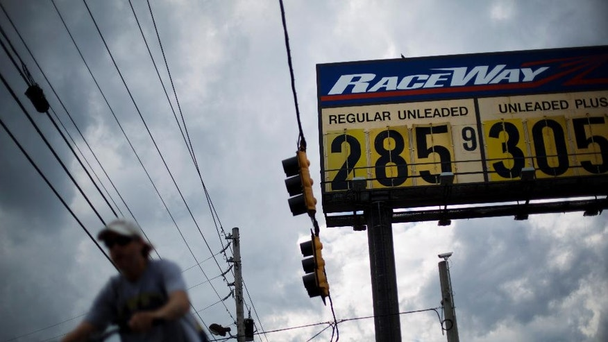In this Wednesday, Oct. 29, 2014 photo, gas station prices are posted for passing motorists in Augusta, Ga. The U.S. is on track for the lowest annual average gas price since 2010 _ and the 2015 average is expected to be lower even still. (AP Photo/David Goldman)
