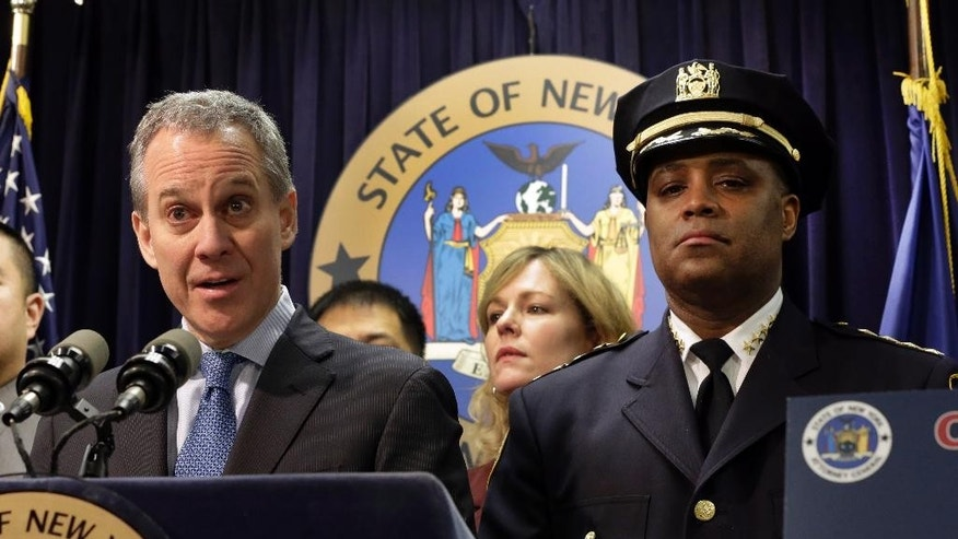 FILE- In this Jan. 30, 2014 file photo, New York City Police Dept. Chief of Department Philip Banks, right, joins New York Attorney General Eric Schneiderman during a news conference, in New York. On Monday, Oct. 3, 2014, Banks was to have been named first deputy commissioner, second in command at the nation's largest police force; instead, Banks elected to retire. (AP Photo)