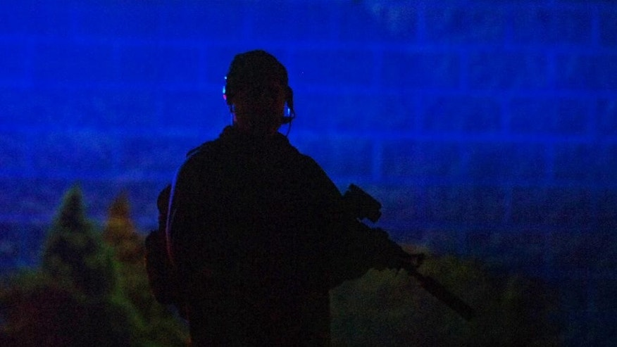 A Pennsylvania State Trooper stands guard in front of the Blooming Grove State Police barracks after suspected killer Eric Frein was captured and taken into custody at the barracks early Friday, Oct. 31, 2014 in Blooming Grove Township, Pennsylvania.    (AP Photo/The Scranton Times-Tribune, Butch Comegys)