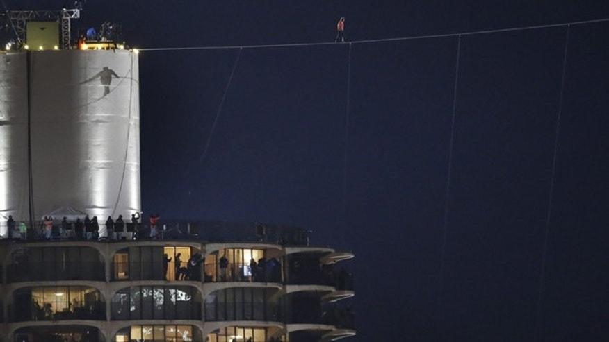 Nov. 2, 2014: The shadow of daredevil Nik Wallenda is cast against the West Marina Tower as he begins his tightrope walk uphill at a 19-degree angle, from the Marina City west tower across the Chicago River to the top of the Leo Burnett Building in Chicago.