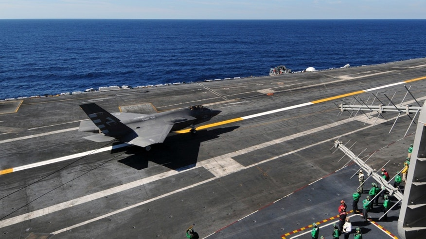 Nov. 3, 2014: This photo provided by the US Navy shows an F-35C Joint Strike Fighter conducts its first arrested landing aboard the aircraft carrier USS Nimitz 40 miles off San Diego, Calif. (AP/U.S. Navy, William Cousins)