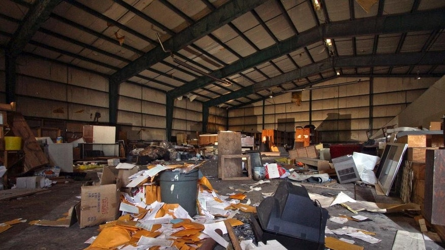 Debris is strewn about the main room inside the airport hangar on abandoned Birchwood Resort grounds in Pocono Township, Pa., Tuesday, Nov. 4, 2014,  where where accused Pennsylvania State Trooper killer Eric Frein was arrested last Thursday. Frein evaded capture for 48 days as law enforcement officers combed the wooded countryside. (AP Photo/Scranton Times & Tribune, Michael J. Mullen)  WILKES BARRE TIMES-LEADER OUT; MANDATORY CREDIT