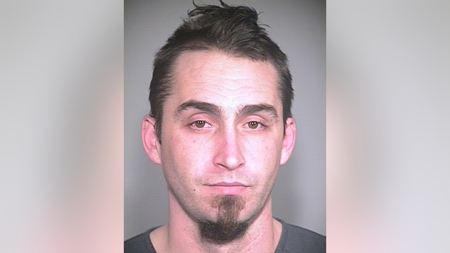 This image released by the Portland, Ore., Police Bureau, shows David Kalac, 33, who police say is a suspect in the killing of a woman in Port Orchard, Wash., where graphic photos of the victim's body were posted online hours before before police found the body. ( AP Photo/Portland Police Bureau)