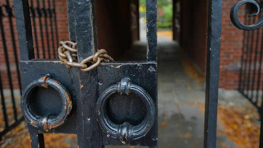 Oct. 4, 2014: A gate to Harvard Yard is chained and locked shut