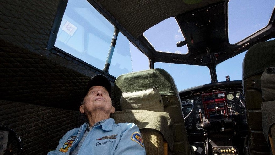 "Retired World War II bombardier Robert Scroggins, 92, sits in the cockpit as he prepares to fly in a B-17 bomber ""Aluminum Overcast,"" for the first time since the war, Thursday, Oct. 30, 2014, in Montgomery, Ala. Keeping the old warbirds in the air is an unusual challenge for crews who maintain the planes that are currently touring the Southeast. ""I'm excited to fly in a plane where I'm not being shot at,"" Scroggins said. (AP Photo/Brynn Anderson)"