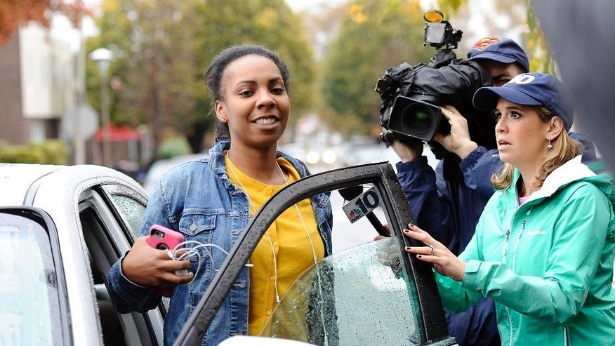 CORRECTS SPELLING OF FIRST NAME TO CARLESHA  - Cinquetta Barfield, cousin of kidnapping victim Carlesha Freeland-Gaither, talks to the media gathered outside the family home in Philadelphia on Thursday, Nov. 6, 2014. Law enforcement agents rescued Freeland-Gaither Wednesday outside Baltimore and arrested suspect Delvin Barnes. (AP Photo/Michael Perez)