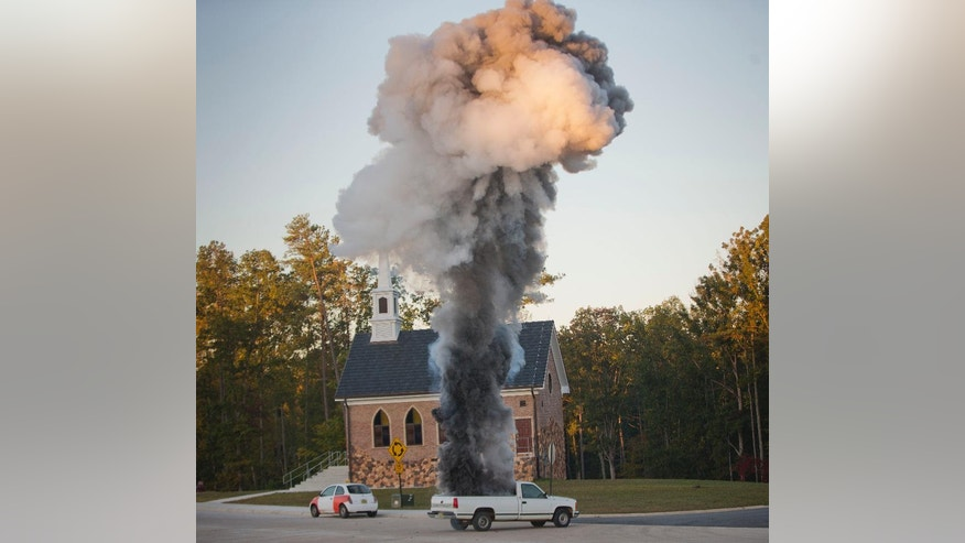"A truck with an explosive is detonated on a street during a US Diplomatic Security Service High Threat training program held at a mock town named Erehwon, ""nowhere"" spelled backwards, on a rural Virginia military base, Thursday, Oct. 9, 2014. Two years after the deadly attack on a U.S. facility in Benghazi, Libya, the Diplomatic Security Service that is responsible for protecting some 100,000 Americans around the world has dramatically expanded training.  (AP Photo/Pablo Martinez Monsivais)"