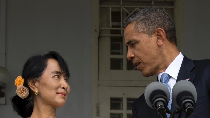 FILE - In this Nov. 19, 2012, file photo, U.S. President Barack Obama and Myanmar opposition leader Aung San Suu Kyi speak to press at her residence in Yangon, Myanmar. President Barack Obama's first visit to Myanmar in 2012 was a celebration of the nation's historic shift from military rule. But as Obama returns in 2014, optimism over economic and political reforms has faded. (AP Photo/Carolyn Kaster, File)