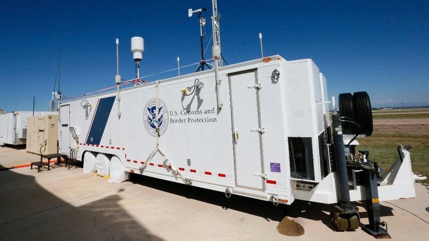 A U.S. Customs and Border Patrol drone flight trailer, where pilots operate drone aircraft, is shown Wednesday, Sept 24, 2014 at Ft. Huachuca in Sierra Vista, Ariz. The U.S. government now patrols nearly half the Mexican border by drones alone in a largely unheralded shift to control desolate stretches where there are no agents, camera towers, ground sensors or fences, and it plans to expand the strategy to the Canadian border. It represents a significant departure from a decades-old approach that emphasizes boots on the ground and fences. (AP Photo/Matt York)