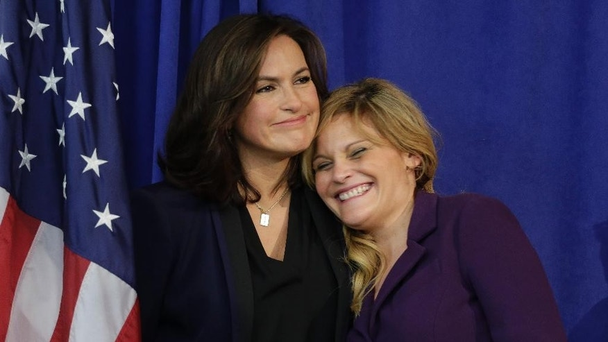 Actress Mariska Hargitay, left, hugs rape victim and founder of Natasha's Justice Project, Natasha Alexenko, during a news conference in which Manhattan District Attorney Cyrus R. Vance Jr. announced that he pledged as much as $35 million to help eliminate a backlog of untested rape kits nationwide that has long troubled authorities, victims and lawmakers, Wednesday, Nov. 12, 2014, in New York. (AP Photo/Julie Jacobson)