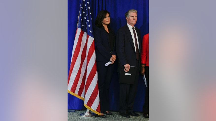 Actress Mariska Hargitay, left, and Manhattan District Attorney Cyrus Vance Jr. listen as Detroit prosecutor Kym Worthy talks about Vance's pledge of $35 million in funding to help eliminate a nationwide backlog of rape kit testing, Wednesday, Nov. 12, 2014, in New York. Evidence from up to 70,000 rape cases nationwide will get long-awaited DNA testing. Experts estimate hundreds of thousands of rape kits — swabs and specimens gathered during exams victims undergo after attacks — remain to be tested for genetic evidence that could identify or eliminate a suspect.  (AP Photo/Julie Jacobson)