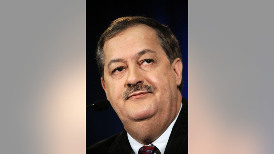 FILE - In this April 26, 2010 file photo, Massey Energy Co. Chairman and CEO Don Blankenship attends a news conference in Charleston, W.Va. On Thursday, Nov. 13, 2014, Blankenship was indicted on federal charges related to a mine safety investigation following the 2010 fatal explosion at the Upper Big Branch mine.(AP Photo/Jeff Gentner, File)