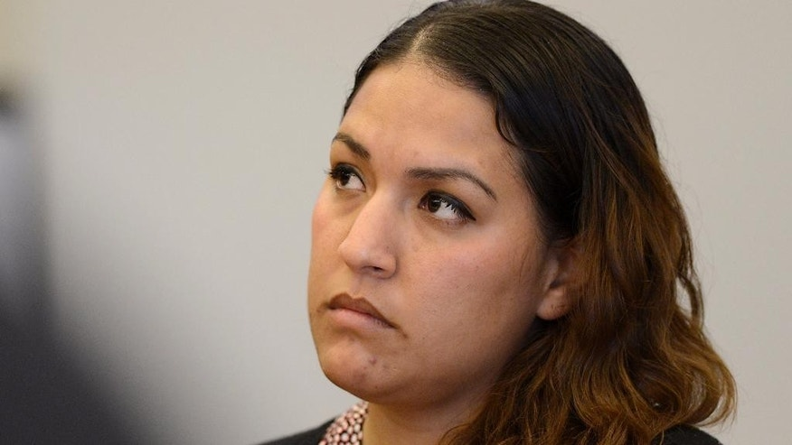 FILE - Defendant Candace Brito listens to closing arguments in Santa Ana, Calif., in this Wednesday, July 23, 2014 file photo. Brito and Vanesa Zavala were convicted earlier this year of voluntary manslaughter and assault in the death of a third woman who died after a brawl outside a popular California nightclub face up to 11 years in state prison at their sentencing hearing Friday Nov. 14, 2014. (AP Photo/The Orange County Register, Christine Cotter, Pool, File)