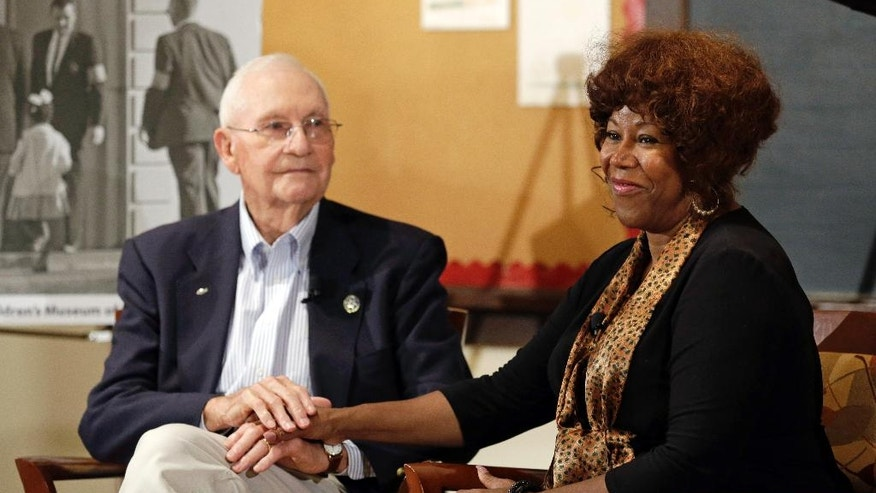 FILE - In this Thursday, Sept. 5, 2013, file photo, Ruby Bridges, right, who integrated Louisiana schools in 1960 under escort from U.S. Marshals, meets with Charles Burks, who was one of those marshals, at the Indianapolis Children's Museum in Indianapolis. On Friday, Nov. 14, 2014, 54 years later to the day when she first walked up the steps to William Frantz Elementary School, Bridges is scheduled to commemorate the event with the unveiling of a statue in her likeness on the campus. (AP Photo/Michael Conroy, File)
