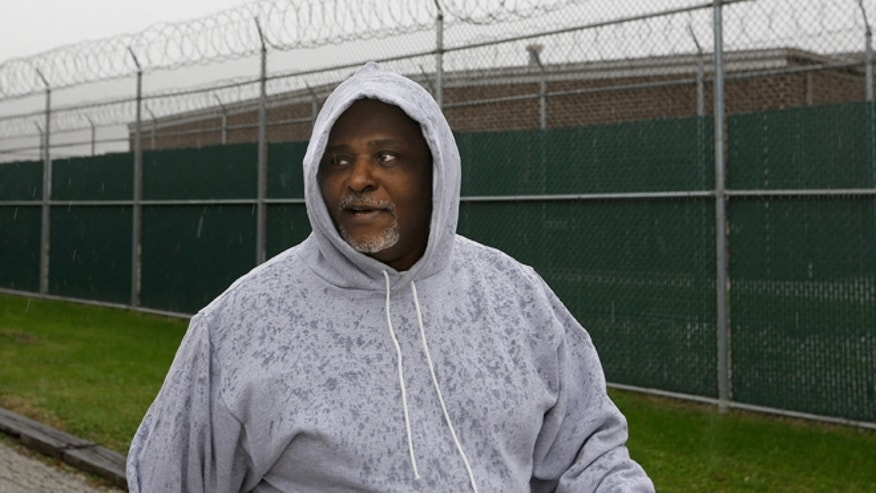 Alstory Simon was freed from the Jacksonville Correction Center in Jacksonville, Ill., on Oct. 30.  (AP Photo/Seth Perlman)
