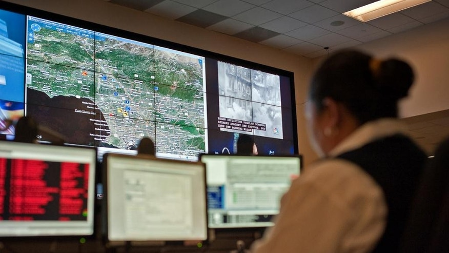 "This Oct. 4, 2010 photo provided by Jupiter Systems, the manufacturer of the display wall processors seen in the photo, shows the Los Angeles Police Department's downtown command center. Los Angeles police are increasingly relying on technology that not only tells patrol officers where crime is most likely to occur but also identifies and keeps track of ex-cons and other bad guys they believe are most likely to commit them. Police say the effort has already helped reduce crime in Newton Division, one of the city's most notorious and historically gang-ridden neighborhoods, grimly nicknamed ""Shootin' Newton."" The program - part data collection, part lightning-fast computer platform, part street-level intelligence-gathering - is expanding in Los Angeles with the help of a recent federal infusion of $400,000 and has drawn interest from departments across North America. (AP Photo/Jupiter Systems, Brad Howell)"
