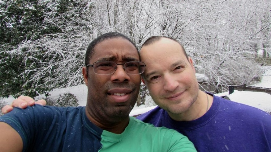 This undated photo, provided by Alex Teal, shows Teal, left, and his longtime partner, Stephen White of Greensboro, N.C. White was in critical condition after being beaten and burned, allegedly by a man he met at a Greensboro gay bar on Sunday, Nov. 9, 2014. (AP Photo/Alex Teal)