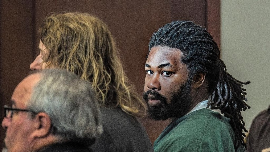Jesse Matthew, right, looks toward the gallery while appearing in court on Friday, Nov. 14, 2014 in Fairfax, Va.  Matthew, accused of abducting Hannah Graham, a University of Virginia student who was found dead last month,  pleaded not guilty Friday on an unrelated sexual assault charge. Matthew, 32, is charged with attempted capital murder and other counts stemming from a September 2005 attack on a 26-year-old woman in Fairfax City.   (AP Photo/The Washington Post, Bill O'Leary, Pool)