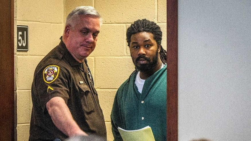 Jesse Matthew, right, is led into court on Friday, Nov. 14, 2014 in Fairfax, Va.  Matthew, accused of abducting Hannah Graham, a University of Virginia student who was found dead last month,  pleaded not guilty Friday on an unrelated sexual assault charge. Matthew, 32, is charged with attempted capital murder and other counts stemming from a September 2005 attack on a 26-year-old woman in Fairfax City.   (AP Photo/The Washington Post, Bill O'Leary, Pool)
